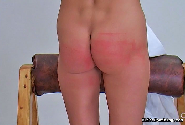 Preview Elite Spanking - Hot red head gets her ass paddled.0